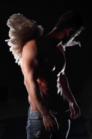 naked man: naked muscular man with wings Stock Photo