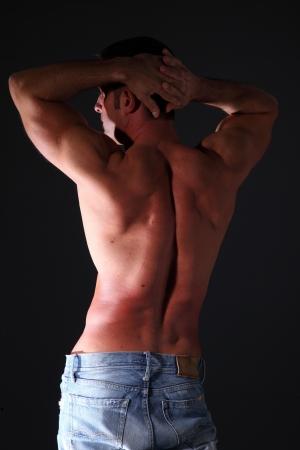 seminude: seminude muscular man black background Stock Photo