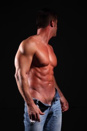muscular man: seminude muscular man black background Stock Photo