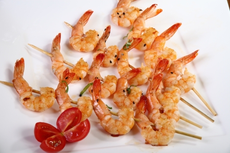 shrimp skewers on white plate photo