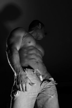 white black muscular man in jeans photo