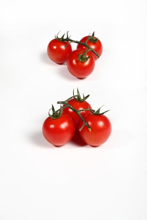 six cherry tomatoes on white photo
