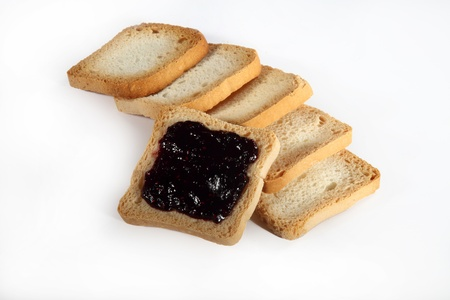 group biscuits with jam on white background photo