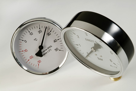 barometer: industrial thermometer and barometer on a white background