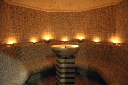 turkish bath: gym - room for turkish bath with central fountain and candles