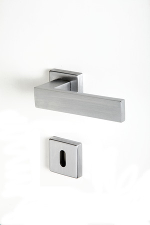 hermetic: aluminum handle with lock on a white background Stock Photo