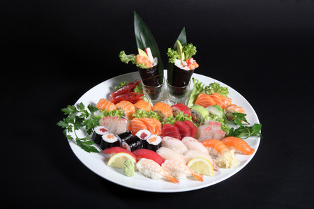 sushi: round plate of sashimi and sushi with mixed vegetables and ice