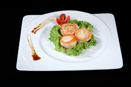 seaa: scallop dish with vegetables on a black background Stock Photo