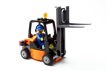 forklift: toy man on forklift truck on a white background Stock Photo