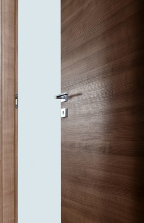 new entry: colored wooden door open, with the handle, on white background Stock Photo