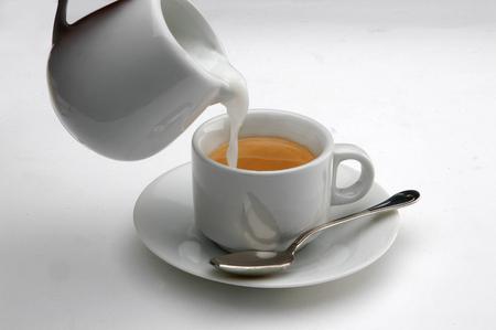 expressed: Italian espresso cup and milk jug