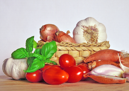 Italian cuisine, tomato sauce. Ingredients for preparation, tomato, onion, garlic, basil Stock Photo