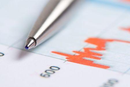 Pencil over paper report photo