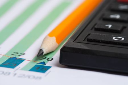 Pencil and calculator over paper report Stock Photo - 4669213