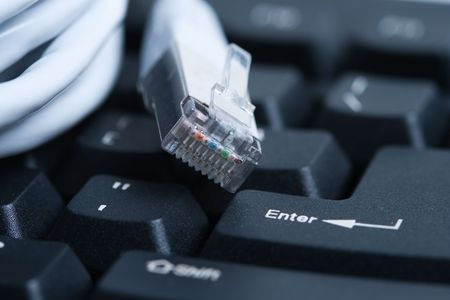 network cable: Computer keyboard and network cable Stock Photo