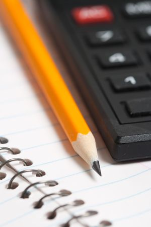 Pencil and calculator over a paper file photo
