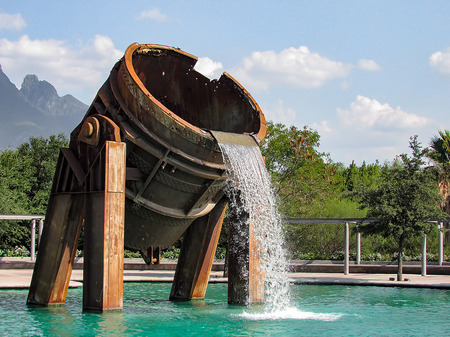 smelting plant: Fountain made of parts of a metal melting furnace Stock Photo