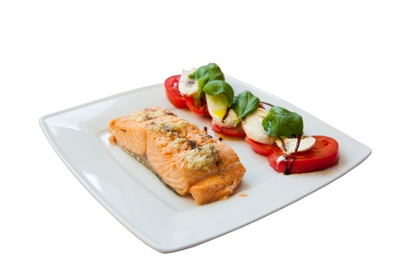 Salmon with tomatoes and basil  Greece  The view from the top  White background  Stock Photo