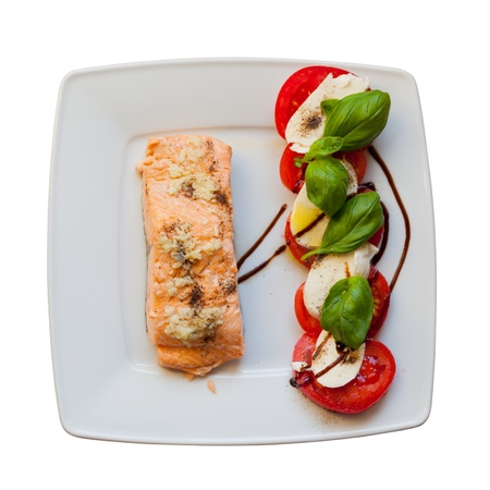 Salmon with tomatoes and basil