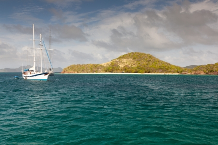 White yacht, blue water and cloudy blue sky. Amazing colours. Nera green island.