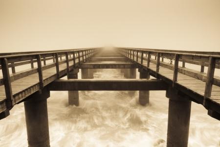 Wooden pier in the fog