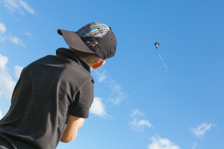 Small boy with a kite  Focus on boy  Back