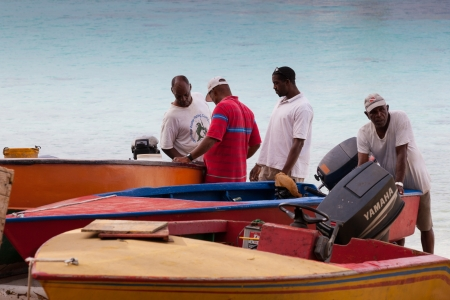 Five fishermen boats checks after returning from the sea  Moustique a small island