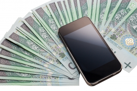 unbranded: Unbranded cell phone. Blank screen. Thin silver cover. A lot of Polish zloty. PLN. Stock Photo