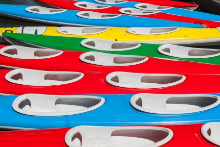 Full frame of colorful kayaks  Close up  Background  Red, blue, green and yellow