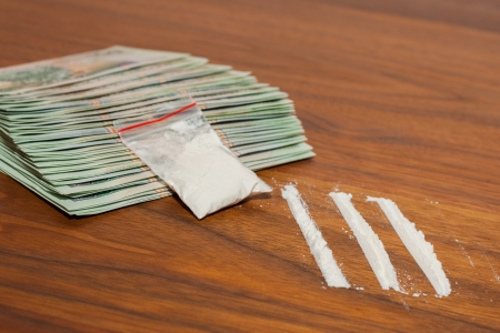 A lot of money and drugs  narcotic, cocaine  on a wooden table  Polish zloty  Stock Photo