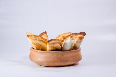Empanadas in a pot Stock Photo - 105254965