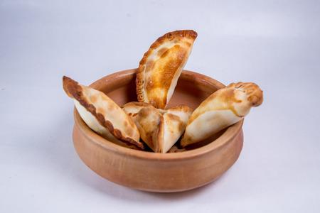 Empanadas in a pot Stock Photo - 105254971