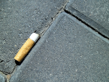 Fag end on the pavement