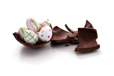 canto: Broken Easter egg on white background