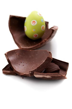 canto: Broken chocolate Easter egg on white background Stock Photo