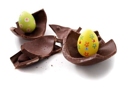 canto: Broken Easter egg in pieces on white background