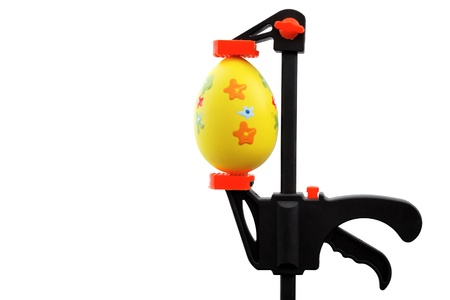 Easter theme: Easter egg and vise grip Stock Photo - 18317836