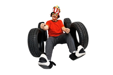 Crazy and funny driver with new tires isolated on white background
