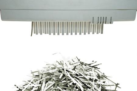 prick: Paper shredder and shred mount isolated on white background Stock Photo