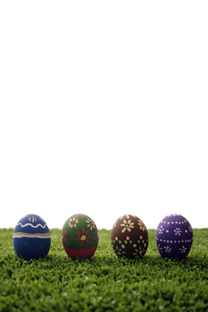 Painted Eggs on grass on a white background. photo
