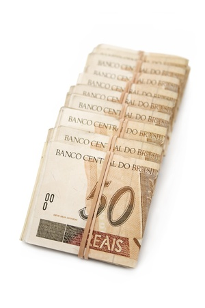 rubberband: Brazilian money tied and piled