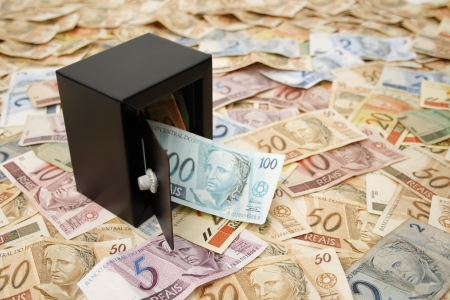 Reais (Real), Brazilian money background and safe. Stock Photo