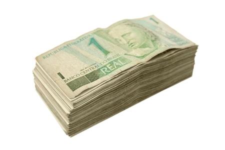 rubberband: Brazilian money piled Stock Photo