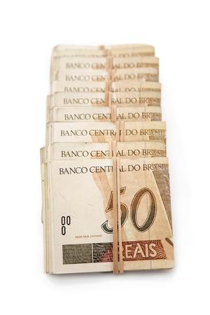 rubberband: Dinero brasile�o atados y apilados