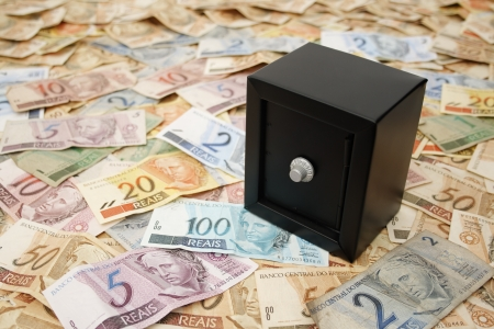 capitalist: Reais (Real), Brazilian money background and safe. Stock Photo