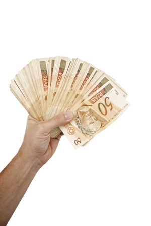 rubberband: A hand holding Brazilian money.