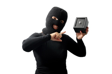Thief holding a safe isolated on white background photo