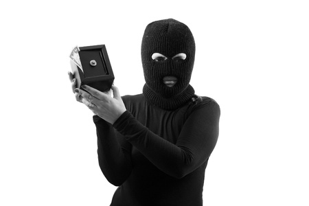 Thief girl holding a safe - B W isolated on white background photo