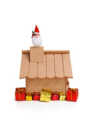 Santa Claus coming from chimney on white background Stock Photo - 18582275