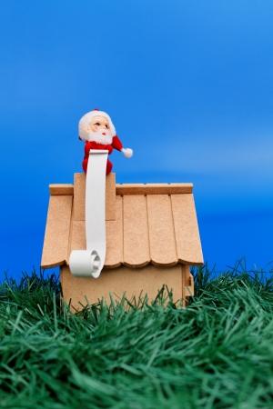 wish list: Christmas theme: Santa on roof with a wish list Stock Photo